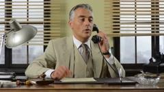 Confident vintage businessman working at desk Stock Footage