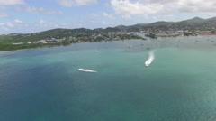 Speedboats on ocean as drone pulls into coastline Stock Footage