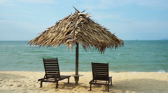 FULL HD beach hut, wooden chair at the beach of South China Sea, loop. Stock Footage