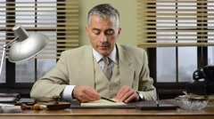 Confident manager checking paperwork in the office Stock Footage