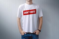 Handsome man wearing shirt with Don't vote title - stock photo