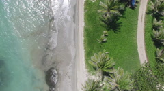 Aerial of tide hitting small beach Stock Footage