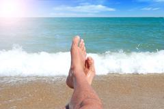 Legs the sea horizon Stock Photos