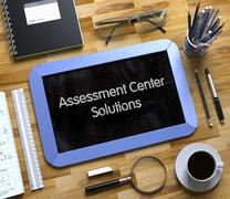 Assessment Center Solutions Concept on Small Chalkboard Stock Illustration