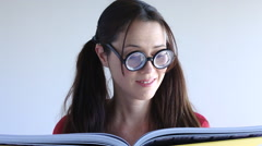 Geeky women read a book Stock Footage