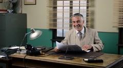 Vintage businessman reading financial news Stock Footage