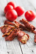Fresh and dried tomatoes. - stock photo