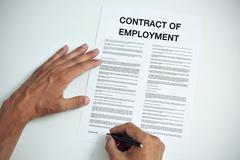 Man signing a contract of employment Stock Photos