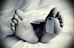 Dead body with a blank toe tag, in monochrome Stock Photos