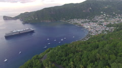 Pull back from boats and cruise ship docked at bay in Malta mountain Stock Footage