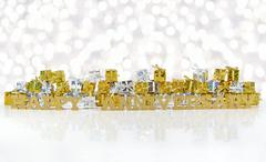 Happy anniversary golden text and golden and silver gifts Stock Photos