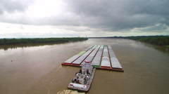 Scenic aerial pulling back from barge on Mississippi River Stock Footage