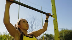 Sportswoman pull on the crossbar at sports ground Stock Footage