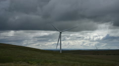Wind turbine time lapse on windy day with clouds Stock Footage