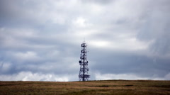 Antenna tower time lapse on windy day with clouds Stock Footage