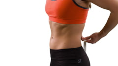 Sexy woman measuring waist Stock Footage