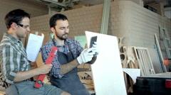 Two carpenters makes lots of selfie in workshop Stock Footage