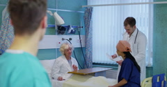 Portrait of smiling male doctor on a hospital ward Stock Footage