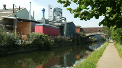 Grand Union Canal, Birmingham, factory and bridge. Stock Footage