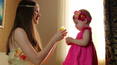 Clouse-up portrait. Mom puts little daughter flowers on hair. small child Stock Footage
