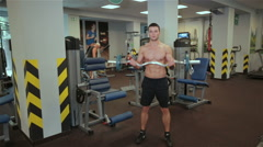 The man raises the bar in the gym Stock Footage