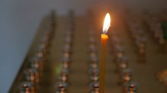 Candles dark in the church russian orthodox of service sacrament slow motion Stock Footage