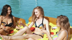 Happy girls with beverages on summer party near the pool. 20s. 1080p Super Slow Stock Footage