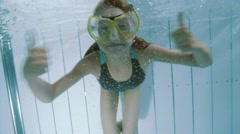 Underwater girl in aquapark Stock Footage