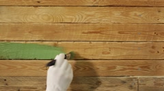 Painting wooden wall to green colour Stock Footage