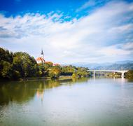 Old Church on River Bank. Slovenia, Europe. Stock Photos