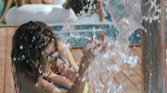 Young beautiful woman taking a shower outdoors in bikini Super Slow Motion Stock Footage