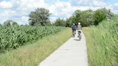 Couple cycling along the havel river Stock Footage