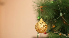 Openwork gold balls on a Christmas tree Stock Footage