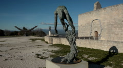 Sculptures outside the ruined castle of the Marquis de Sade, Lacoste, France Stock Footage