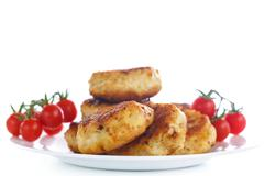 Fried chicken cutlet with cherry tomatoes Stock Photos