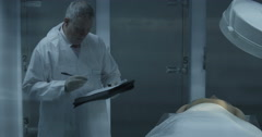 A mortician is making notes Stock Footage