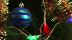 Blue ball with garland on a Christmas tree Stock Footage