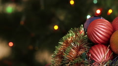 Christmas balls and fir tree with garland flashing. Background - stock footage