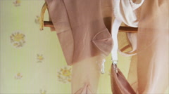 Vintage stockings and garters on hanger Stock Footage