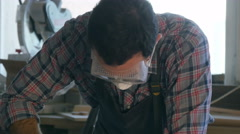 Carpenter working with Industrial tool in wood factory wearing safety glasses Stock Footage