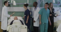 Attractive group of medical personnel of mixed ages and ethnicities stand and Stock Footage