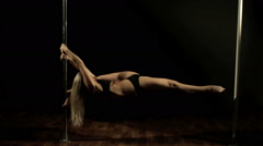 Professional Pole Dance. Young beautiful woman performs sensual dance. Stock Footage