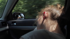 Wind Blowing Through Girl's Hair. Tired teenager girl sleeping in car Stock Footage