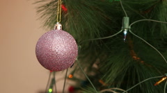 Purple ball in sequins on the Christmas tree. Stock Footage