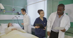 A doctor and an attractive young nurse on a hospital ward Stock Footage