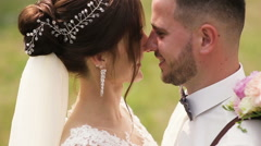 Happy newlywed bride and groom kissing, realizing that they are married now Stock Footage