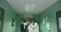 A group of three friendly young medical personnel Stock Footage