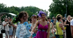 The girl in the purple dress and the girl in the blue dress with the bikes Stock Footage