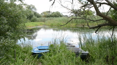 Rowing boat on shore of Havel river (Brandenburg Germany). Stock Footage