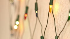 flashing garland on the wall. Christmas background - stock footage